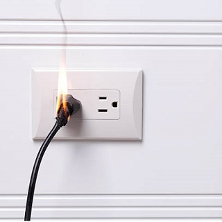 Electrical fire caused by faulty outlet or wiring